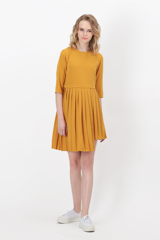 ARIN HI-LO PLEAT DRESS IN HONEY