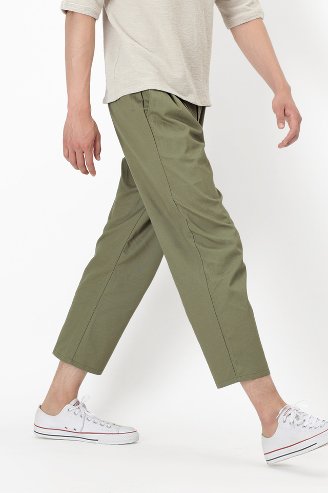 WIDE-FIT PLEATED TROUSERS IN PALE OLIVE