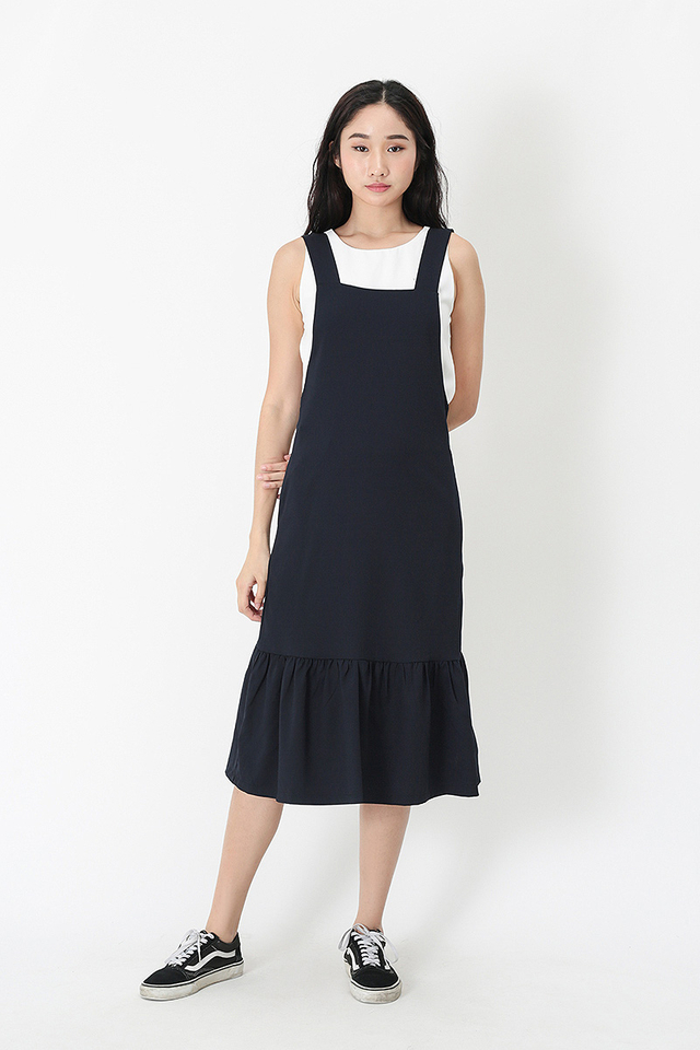 KAMILLE DROP HEM PINAFORE DRESS IN NAVY