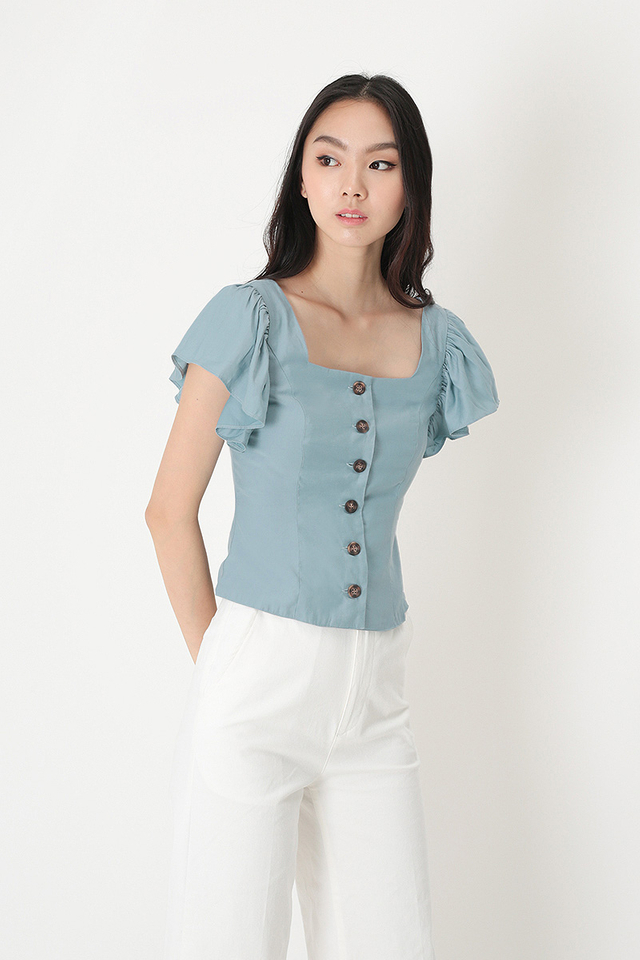 ALLIE FLUTTER SLEEVE TOP IN DUSK BLUE