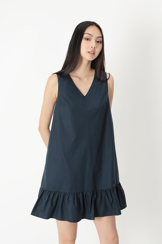 HOLLY DROP HEM DRESS IN NAVY