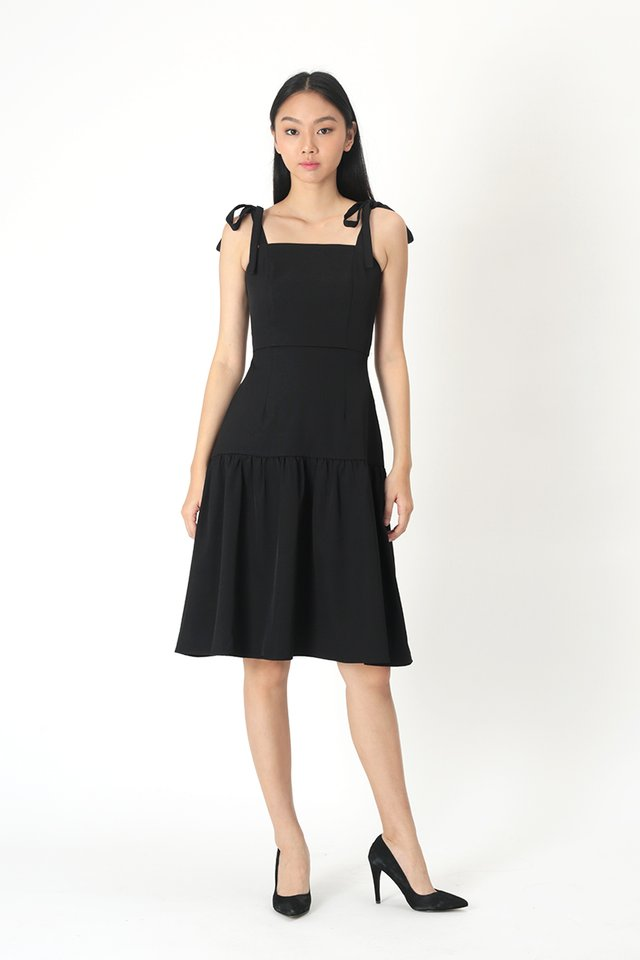 EVANGELINE DROP HEM DRESS IN BLACK