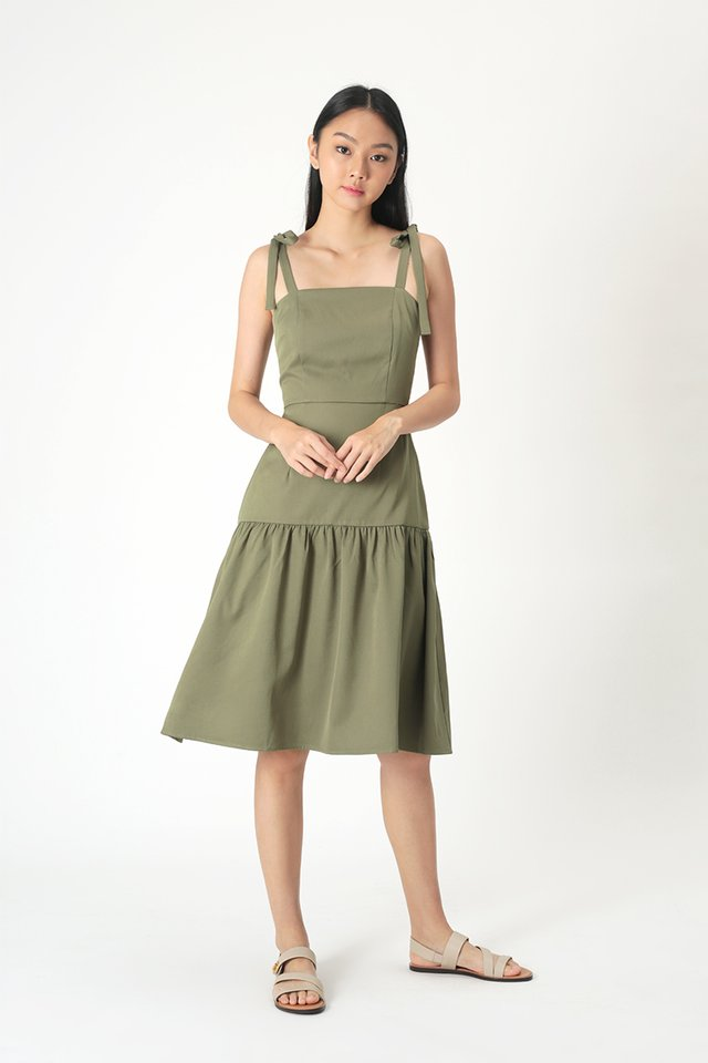 EVANGELINE DROP HEM DRESS IN OLIVE