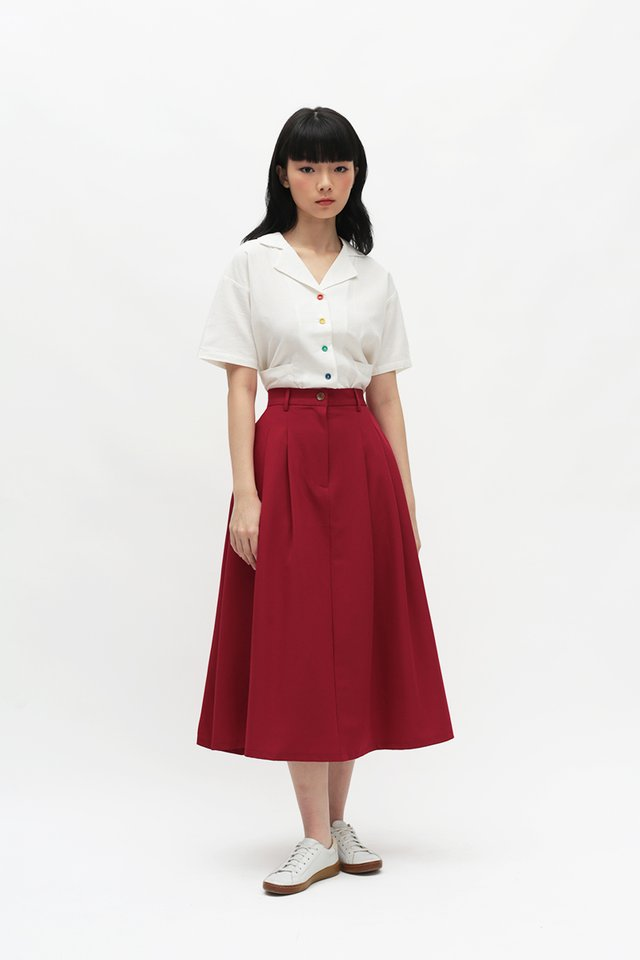ADINA PLEATED SKIRT IN AURORA RED